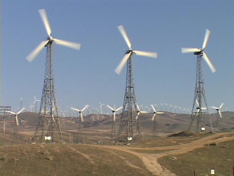 Large windmills spin at a wind-farm, Live Action