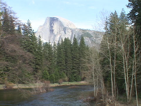 A river runs through Yosemite National Park with the... Stock Video Footage