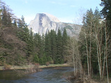 A river runs through Yosemite National Park with the majestic Half Dome in the background Footage