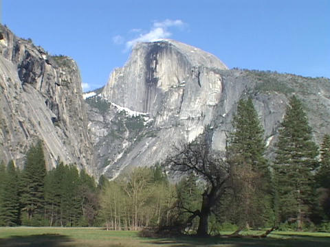 The Half Dome rises majestically above the valley floor in Yosemite National Park Footage