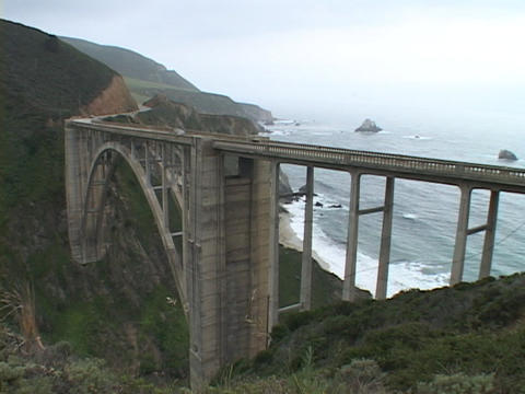 A bridge spans the rocky coastline of the Big Sur area in... Stock Video Footage