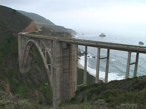 A bridge spans the rocky coastline of the Big Sur area in California Footage