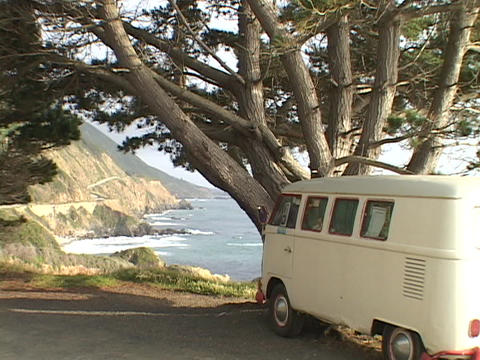 A VW bus sits parked under a tree along the California... Stock Video Footage