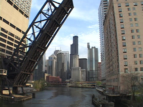 A river runs under a raised drawbridge in Chicago, Illinois Stock Video Footage