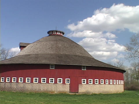 An Amish style round barn stands in Indiana farm country Footage