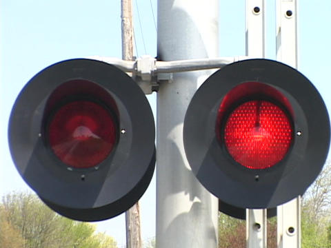 Red lights flash at a railroad crossing Stock Video Footage