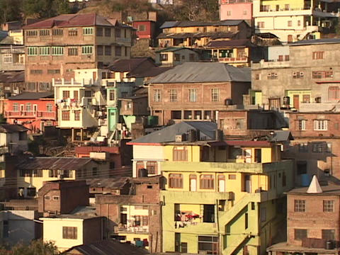 A Tibet style village clings to the mountainside in... Stock Video Footage