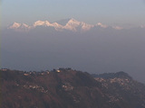 The Himalayan mountains rise behind the city of Darjeeling, India Footage