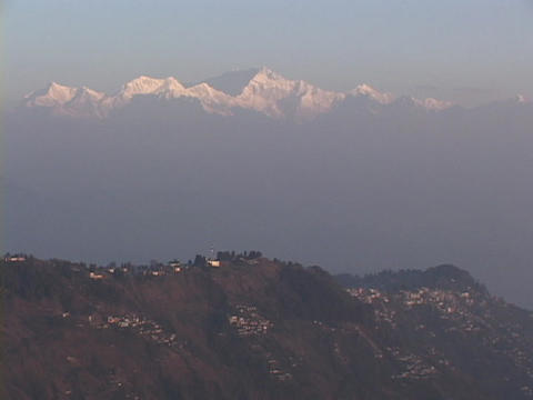 The Himalayan mountains rise behind the city of... Stock Video Footage