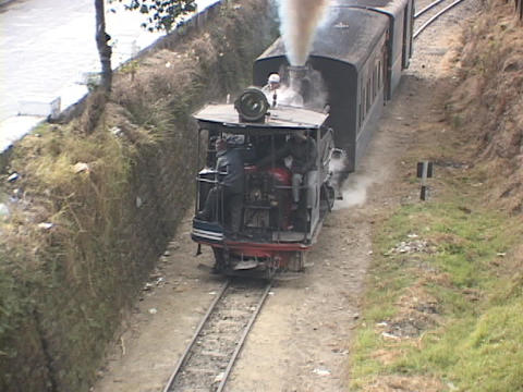 A steam train passes through the Indian countryside Stock Video Footage