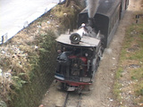 A steam train passes through the Indian countryside Footage