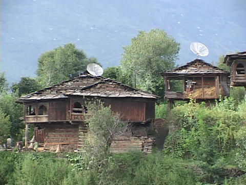 Satellite dishes sit atop vintage huts Footage