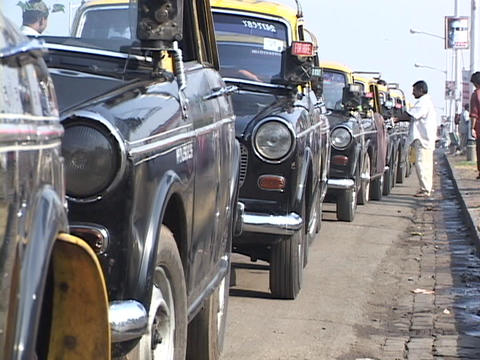 Taxis line up on a Mumbai city street Stock Video Footage