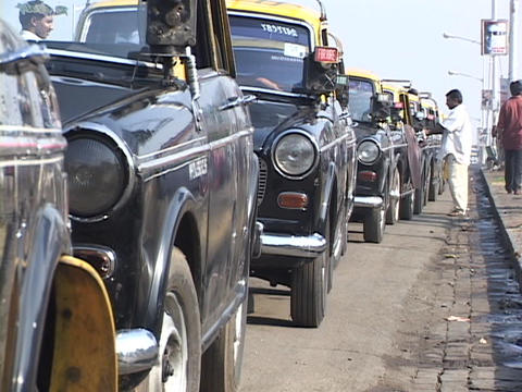 Taxis line up on a Mumbai city street Footage