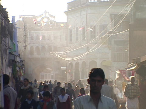 Pedestrians walk on a crowded Indian city street Stock Video Footage