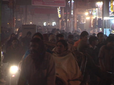 Pedestrians walk on a crowded city street in India Footage