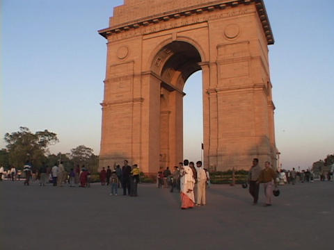 Pedestrians walk near the India Gate in New Delhi, India Stock Video Footage