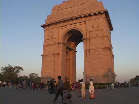 Pedestrians walk near the India Gate in New Delhi, India Footage