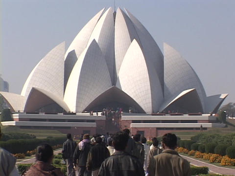 Pedestrians walk to the Baha'i Temple in New Delhi, India Stock Video Footage