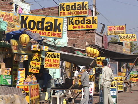 Signs advertise Kodak photo film Footage