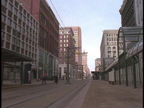 A trolley rolls down a city street in Buffalo, New York Stock Video Footage