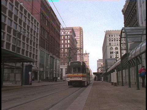 A trolley rolls down a city street in Buffalo, New York Stock Video Footage