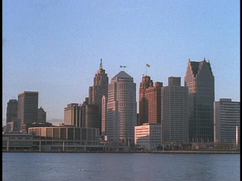 Detroit skyscrapers tower over the river waterfront Stock Video Footage