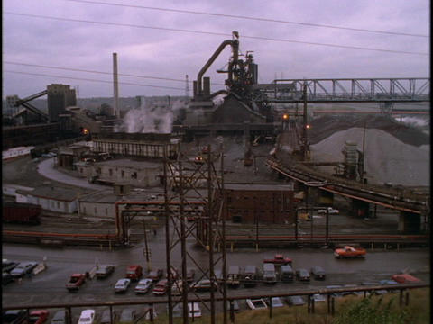 A Sprawling Raw Materials Plant Pumps Out Steam stock footage