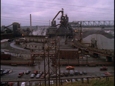 A sprawling raw materials plant pumps out steam Stock Video Footage