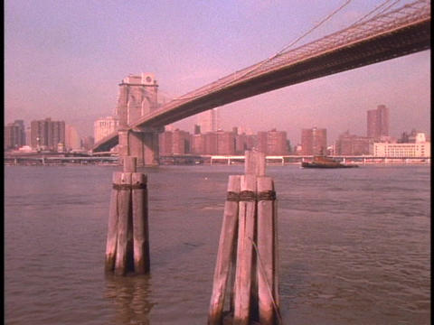 The Brooklyn Bridge towers over New York City's waterfront Footage