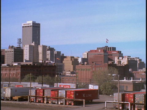 Freight boxes sit outside downtown Omaha, Nebraska Stock Video Footage