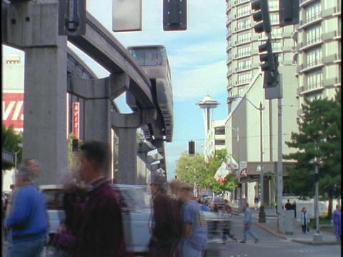 A monorail passes over a busy Seattle street Stock Video Footage
