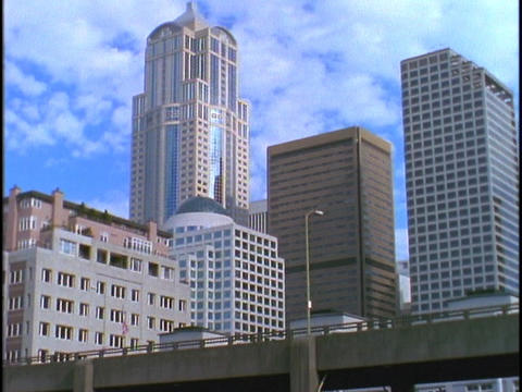 Seattle skyscrapers tower over a highway Stock Video Footage