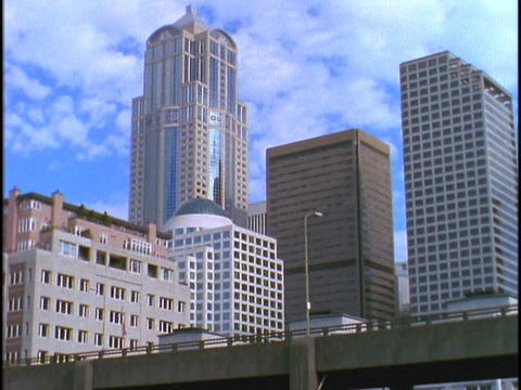 Seattle skyscrapers tower over a highway Footage