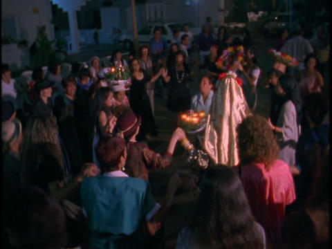 People dance in a circle at a wedding Stock Video Footage