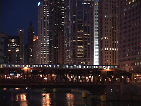 A train crosses over a bridge in downtown Chicago Stock Video Footage