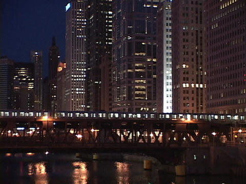 A train crosses over a bridge in downtown Chicago Footage