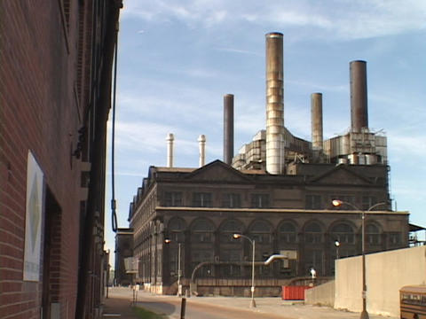 Smoke stacks top an abandoned warehouse Footage