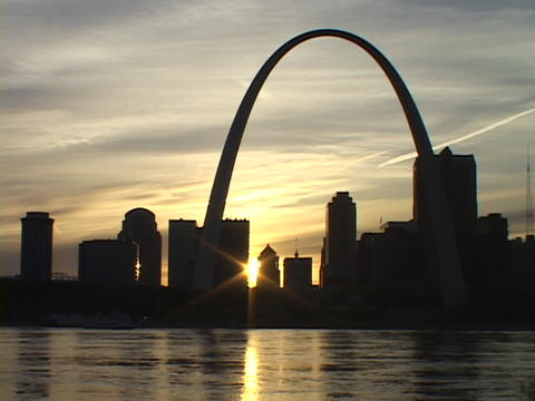 The silhouetted St. Louis skyline adorns the Mississippi River shore Footage