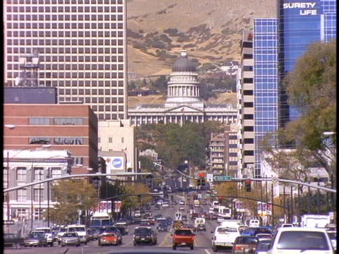 Traffic drives through downtown Salt Lake City Stock Video Footage