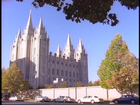 The Mormon Temple rises above Salt Lake City, Utah Stock Video Footage