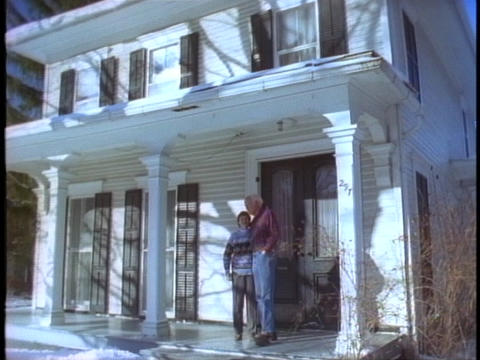 A couple embraces on a porch Footage
