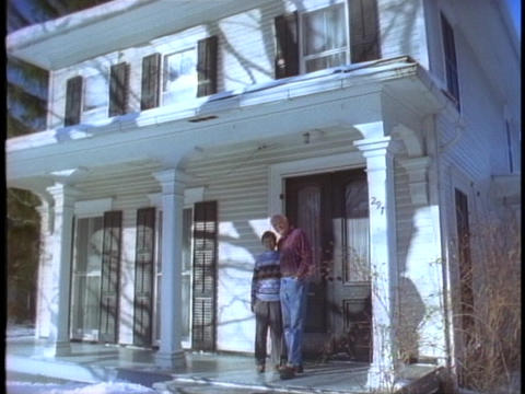 A couple embraces on a porch Stock Video Footage