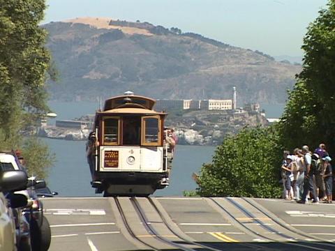 Pedestrians board a cable car in San Francisco Footage