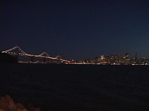 A suspension bridge crosses the San Francisco bay Footage