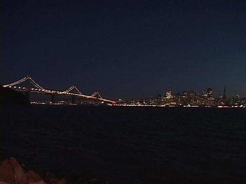A suspension bridge crosses the San Francisco bay Stock Video Footage
