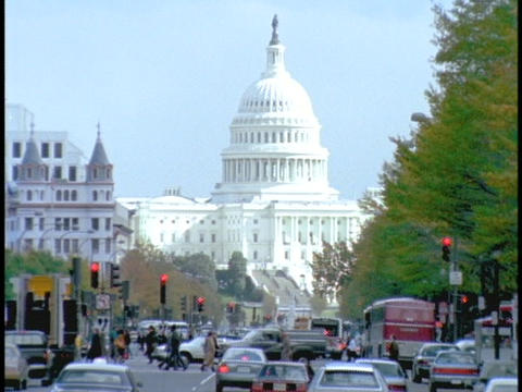 Traffic drives past the US Capitol Building Live Action