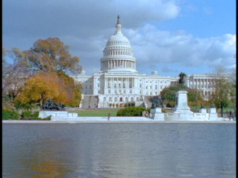 A pond reflects the US Capitol building Stock Video Footage