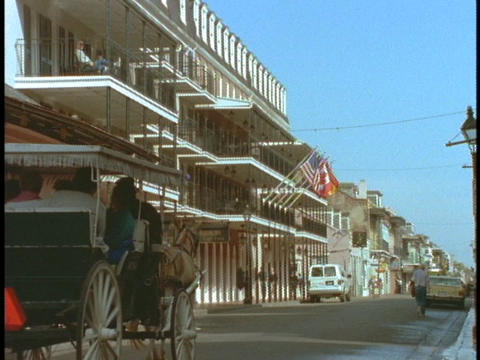 A horse drawn carriage drives through the French Quarter... Stock Video Footage