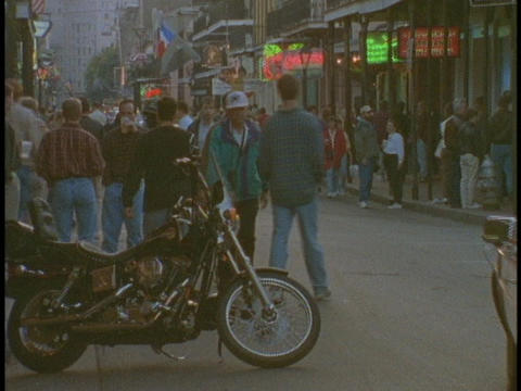 Tourist wander the French Quarter of New Orleans Stock Video Footage